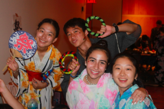 Senior Mia Yang, right, wears a traditional Japanese dress with her fellow campers during the Japanese cultural festival.