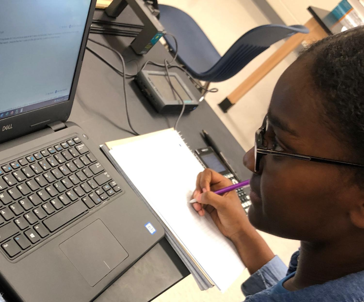 """Compared with Mathspace which allows you to submit your answer in steps and will check and tell you if you're on the right track, it'd be nice if WebAssign could do that,"" junior Eban Ebssa said, working on her Physics 1 WebAssign homework."
