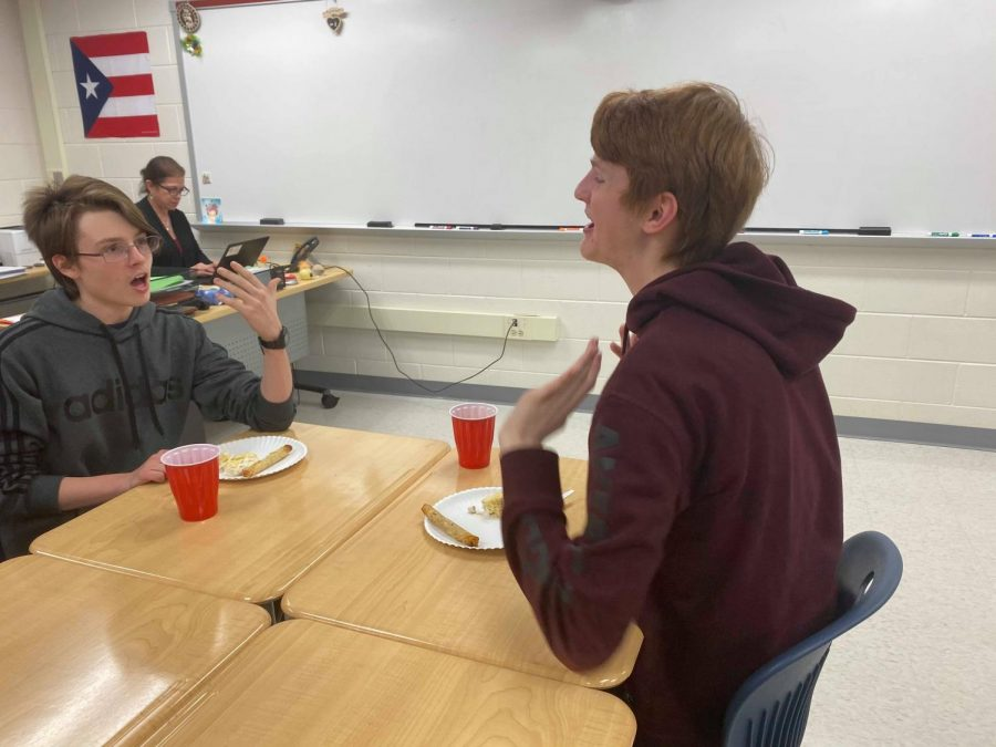"""Sophomores Pearson Frank and David French converse while enjoying the refreshments provided at the Thanksgiving Feast. """"I enjoyed being able to eat food while hanging out with my friends,"""" Frank said."""