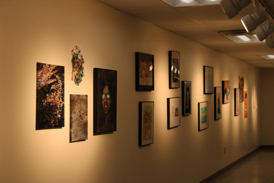 NAHS students' artwork line the walls of the art gallery.