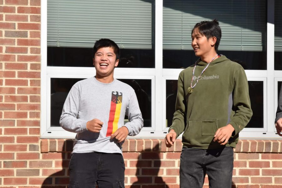 "Senior and Co-President of German Honor Society, Kevin Chung and senior Alex Song dance along to music at German Honor Society's Annual Oktoberfest on Oct. 23. ""My favorite part [of Oktoberfest] was that we had the German kids here and they made the most of it,"" Chung said."