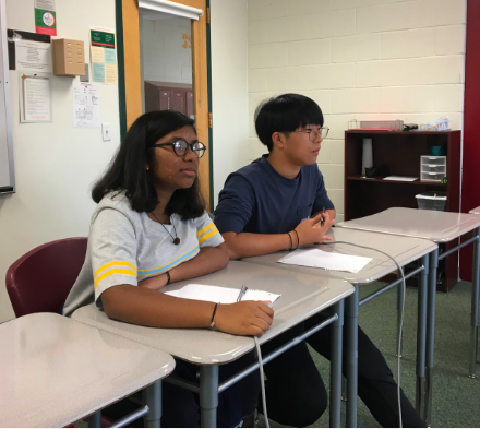 "Freshmen Shriya Muthukumar and Matthew Kim, ready to answer the questions, listen to the question the moderator is asking during the preliminary round of the kickoff. ""It was great since despite the fact we only got two people on the team, we still got third place,"" Kim said."