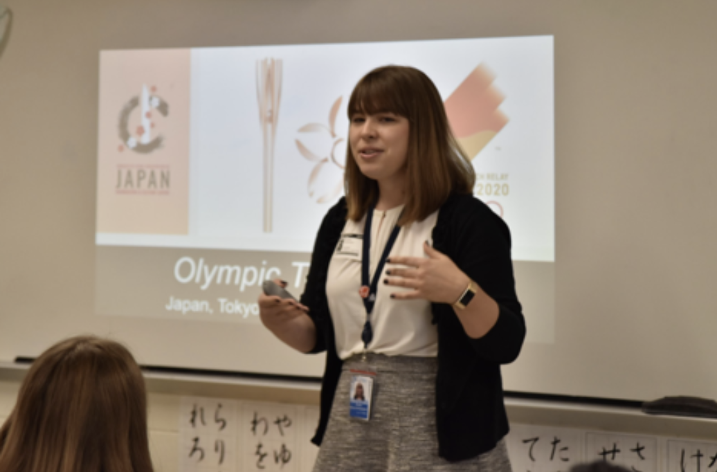 """Representative Melinda Marquardt introduces herself and the history behind Tokyo's plans for the 2020 Olympic Games. """"The Embassy contacted us first,"""" Japanese Teacher Koji Otani explains. """"They wanted us to promote the Tokyo Olympics."""""""