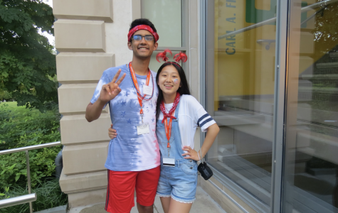 Senior Mia Yang poses alongside junior Vikram Raghu, both decked out in red, white, and blue.