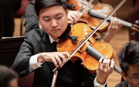 """Senior Jason Pak participated in the National Symphony Orchestra Summer Music Institute (NSOSMI) as a violist this previous summer. """"Thanks to summer camps like SMI, I was able to work with musicians of the NSO (National Symphony Orchestra) and receive a lot of good feedback,"""" Pak said."""