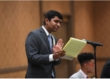 At the 2019 National Speech and Debate Association National Tournament, senior Manu Onteeru speaks passionately to a panel of judges about data privacy and stricter government regulations. Photo by Grace Rogers.