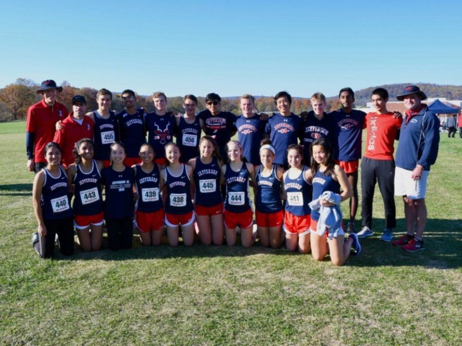 "Placing their arms around each other, the cross-country team poses for a picture after the Regionals competition ""At regionals, [the boy's team] got 3rd place and qualified for the state meet. The girls team also got 3rd and qualified, and we are all really happy about it."" cross-country captain Tucker Stanley said."