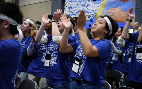 Partaking in a cheer during the 2019 VJCL convention, junior Kelly Mao claps with other Jefferson Latin students
