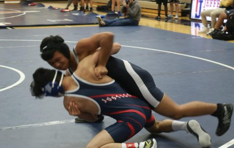 Getting his arm under his opponent, sophomore Ahmad Barokah attempts to drive him into the ground. Barokah, who was down eight and in danger of losing by technical fall, got the pin and 6 points for Jefferson.