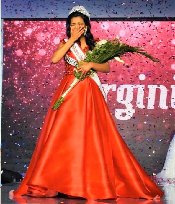"Junior Anjali Nair as her name is called out and wins National American Miss. ""At the National finale, when Miss Iowa and I were the last two girls, I was nervous, but I told myself that I would be happy with the outcome regardless of who won. When they called Miss Iowa as the first runner up, I was definitely in shock, because I had never expected to be a national queen! But I was also very excited about the year ahead,"" Nair said."