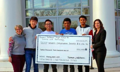 Katherine Phillips (left), sponsor of the SGA, stands with SGA members and a representative of the WCS as the SGA donates the money.