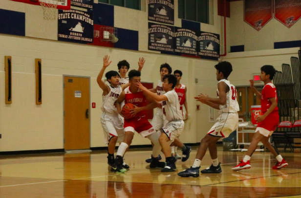 "The Jefferson team hovers over the Annandale player trying to get back on the lead as they attempt to block him from making a pass. ""We should never get too overconfident and we should continue playing aggressive,"" sophomore Vinay Gundu said."