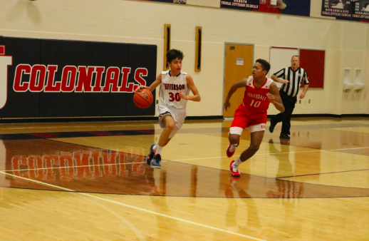 Guarded by an Annandale Atoms defender, sophomore Nathan Singhvi dribbles the ball hoping to make a successful pass. The game is competitive as both teams try to score their first win of the season.