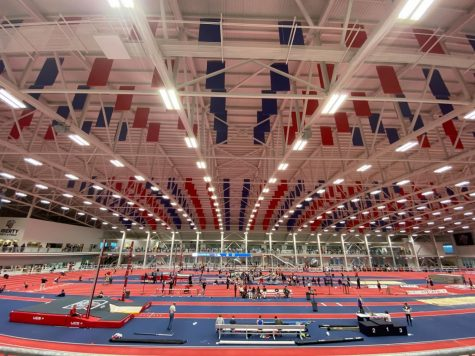 The Liberty University Indoor Track Complex bustles with students, coaches, and parents during the Liberty Premier Invitational meet.