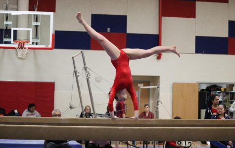 Sophomore Micaela Wells performs her beam routine at the gymnastics meet in Jefferson.