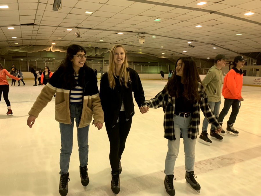 "Juniors Kashika Danjal and Julia Feldhaus and sophomore Faith Wu smile while skating together. ""I loved being able to hang out with my friends in a non-school setting,"" Wu said."