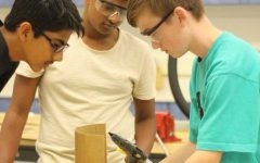 """During a Design & Tech class, freshman Patrick Gaucher works on building a prototype. """"I am worried about college because I know that getting good grades while maintaining a sport and extracurricular is going to be hard,"""" Gaucher said."""