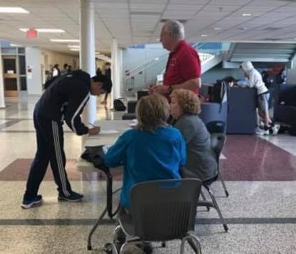 Writing his name down, a student registers to vote on Feb. 3.
