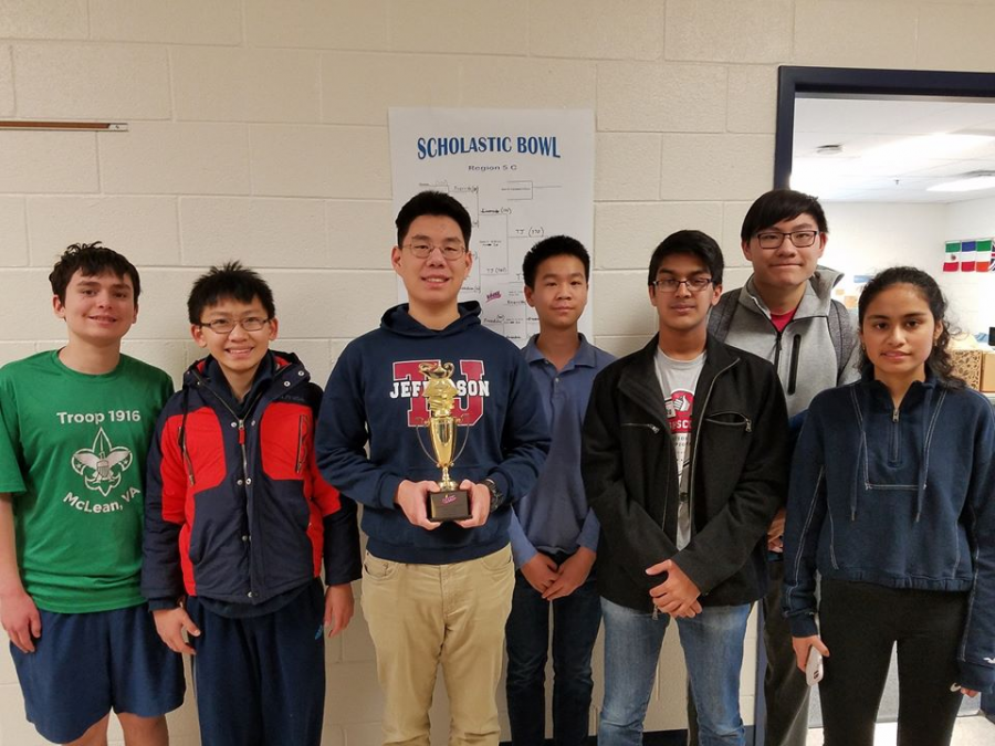 Following+their+victory+at+the+regional+scholastic+bowl%2C+the+Quiz+Bowl+Team+smiles+with+their+trophy