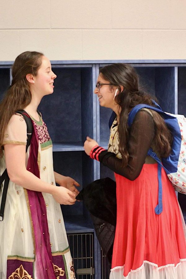 Discussing+eighth-period+plans%2C+senior+Ellie+Rowland+and+Aashna+Johri+dressed+in+traditional+Indian+clothing.+TJ+International+Day+was+a+time+for+students+to+embrace+their+heritage+and+other+cultures.+%E2%80%9CThis+dress+is+called+an+Anarkali+suit%2C+and+traditionally+it+is+worn+in+specific+festivals+like+Diwali%2C+marriages%2C+and+any+sort+of+celebration%2C%E2%80%9D+Johri+said.