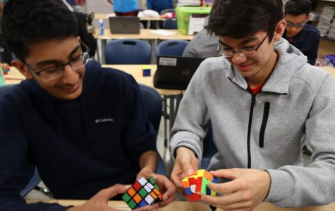Freshman Harsha Ravella and sophomore Michael Fantemi cube together at Rubik's Cube club. Fantemi began his cubing career during third grade after watching his friend solve a cube.