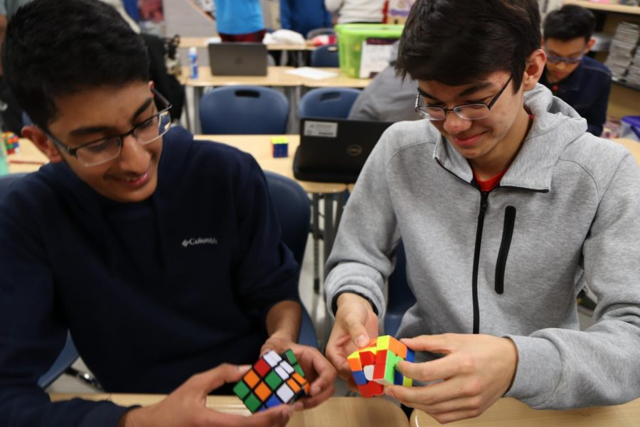 Freshman+Harsha+Ravella+and+sophomore+Michael+Fantemi+cube+together+at+Rubik%27s+Cube+club.+Fantemi+began+his+cubing+career+during+third+grade+after+watching+his+friend+solve+a+cube.+%22One+of+my+friends+showed+me+and+I+thought+the+things+is+so+fast%2C+so+I+wanted+to+do+that%2C%22+Fantemi+said.