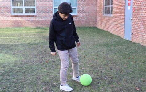 """Freshman Nicholas Artiedamarin practices around with a soccer ball. Soccer is a sport that relies heavily on teamwork and coordination, a characteristic that makes it enjoyable to many players. """"I feel like it's [soccer] a fun sport,"""" freshman Rachit Ravali said, """"and it's interesting to play. You need to be able to work as a team player."""""""