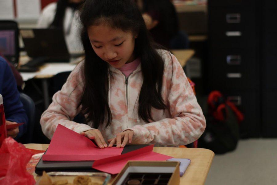 "Freshman Cindy Yang folds her lantern. ""I went to the Lantern celebration because I wanted to do something fun on Friday."" Yang said."