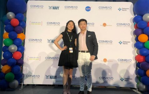Pan and Yang stand in front of the Conrad Challenge backdrop. The pair submitted their product, BACVision, to multiple competitions during their junior year. Photo courtesy of Motoko Schimizu.
