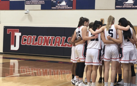 The Jefferson varsity girls basketball team huddled together after a time-out.
