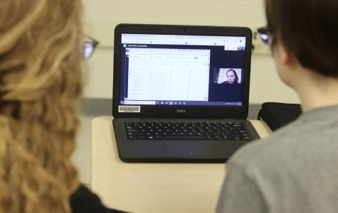 """Seniors Miranda Khoury and Aria Moss engage in a video call with a CosmosID representative on Wednesday, February 12. """"It's really helpful to be able to participate in live video calls instead of video tutorials because we can ask questions in real time,"""" Khoury said."""