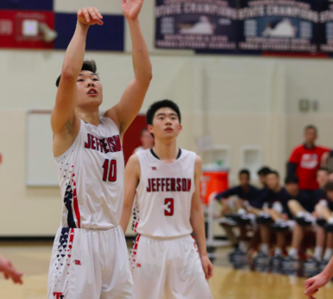 Senior Alex Yu, 10, shoots a free throw during a game earlier in the season. Yu has emerged as a standout athlete during his time at Jefferson