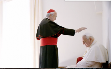 "Cardinale Bergoglio (Jonathan Pryce) stands before a kneeling Pope Benedict (Anthony Hopkins) after the Pope Benedict offered him his title of ""Pope"". The scene took place in a smaller replica of the Sistine Chapel created for the movie."