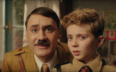 Imaginary Hitler (Taika Watiti) advises child Jojo Betzler (Roman Griffin Davis) before he attends Hitler Youth training camp. This scene serves as a setup to what happens in later stages of the movie.