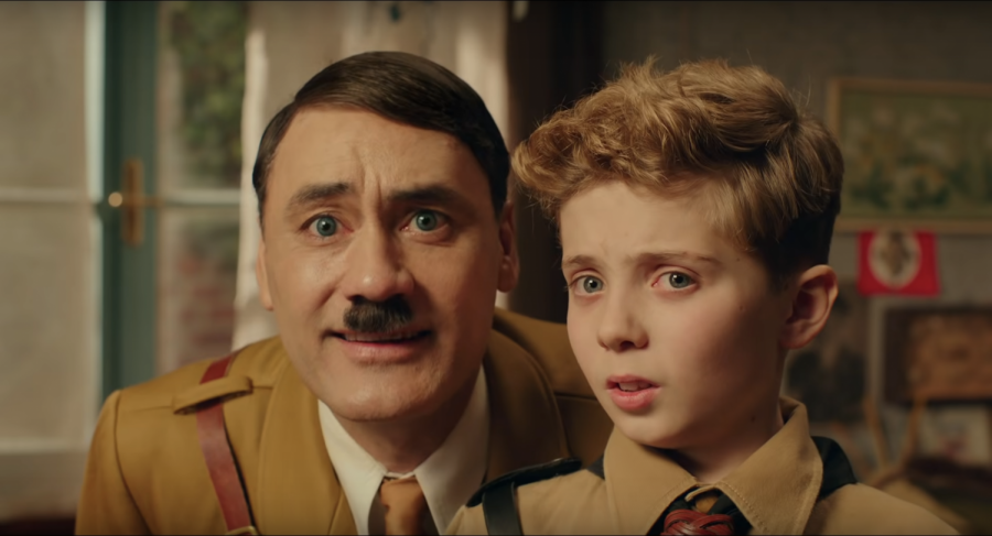 Imaginary+Hitler+%28Taika+Watiti%29+advises+child+Jojo+Betzler+%28Roman+Griffin+Davis%29+before+he+attends+Hitler+Youth+training+camp.+This+scene+serves+as+a+setup+to+what+happens+in+later+stages+of+the+movie.+