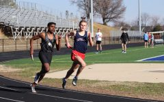Sprinting down the track, senior Tucker Stanley competes in the 4x800 relay