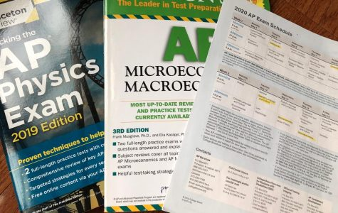 The old 2020 AP exam schedule along with an AP Physics prep book and AP Micro/Macroeconomics prep book. The changes to the 2019-20 AP exam administration are a concern for some.