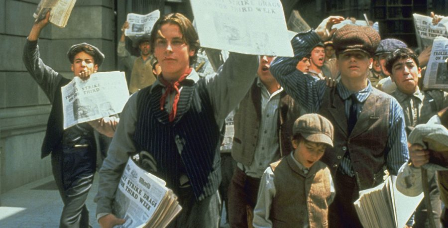 Jack Kelly and his other newsies spreading awareness of the strike of newspaper boys, demonstrating the power of the press, protest, and the voice of the people.