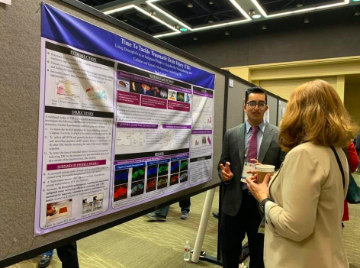 Junior Shan Lateef presents his groundbreaking research on traumatic brain injury to a judge at the 2019 Virginia Academy of Science symposium.