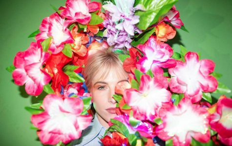 Hayley Williams surrounds herself in flowers in this album art for Petals for Armor