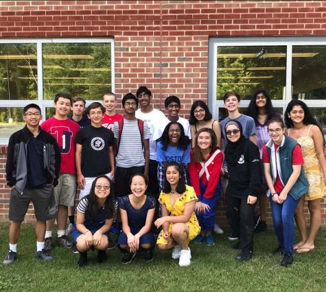 Standing for an end-of-year photo, senior Didi Elsyad joins her freshman IBET class. Elsyad was the only Black student in her class.