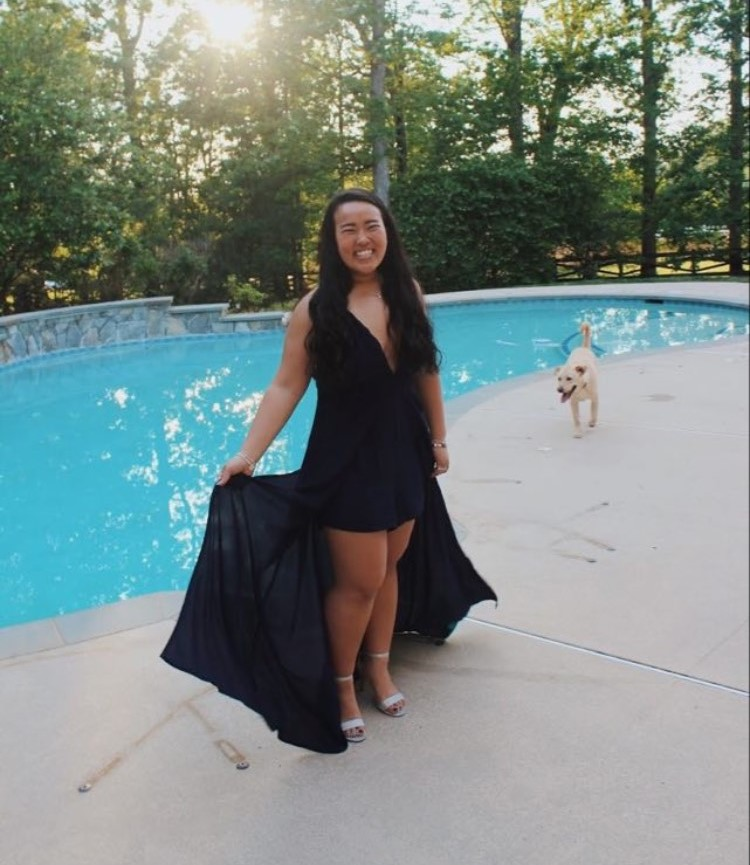 Senior Michelle Pham poses for her individual prom picture in front of her pool.