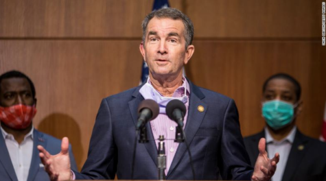Standing on a podium, Virginia Governor Ralph Northam delivers latest Virginia reopening plans.