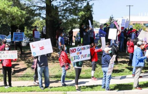Members of the Jefferson community hold up signs criticizing the merit lottery admissions proposal during a protest on Sunday, Sept. 20, 2020.