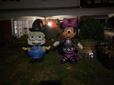 Minnie Mouse and Minion inflatables are set up as part of many decorations to celebrate Halloween.