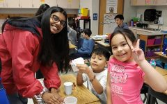 Senior Anoushka Sarkar guides Weyanoke Elementary students through a chromatography lab.