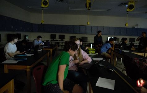 Looking at a computer, students collaborate on a partner assignment in an Astronomy class during the 2019-20 school year. Distance learning has made it harder for students to build and maintain relationships with their peers. Social Emotional Learning activities during Eighth Periods will attempt to address those gaps.