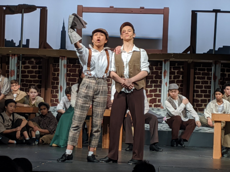 Senior Jenalyn Dizon and Class of 2020 alumnus Andra Velea take a stand in the TJTA's spring 2020 performance of Disney's Newsies.  Photo courtesy of tjtheaterarts.com.