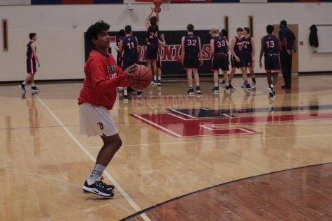 In a moment from last year's winter season, Rakesh Pillai, senior and Varsity Boy's Basketball team member, hopes to return to the court for the 2020-2021 winter sports season.