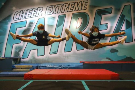 "Performing straddle jumps at Cheer Extreme Fairfax, seniors Matthew Hwang and Jenalyn Dizon attend one of their weekly tumbling practices (9/14/2020). To maintain safety protocols while developing cheer skills, these practices hold only about five students, all of whom must wear masks. ""Tumbling practices really help the team with their abilities, and it's so nice to see other team members, even if it isn't the entire team,"" Dizon said."